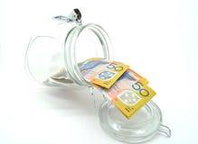 Un poco de dinero australiano en el tarro Foto de archivo libre de regalías