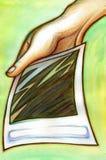 Un polaroid nella mano Illustrazione di Stock