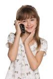 Jolie fille avec un téléphone portable Photographie stock