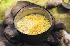 Un pot de nourriture à l'enjeu Photographie stock