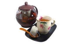 Un pot de thé et une tasse de thé Images libres de droits