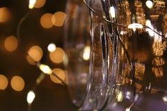 Un pot de verre avec des lumières Image stock