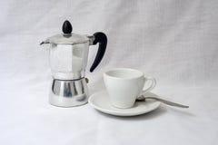 Un pote del coffe y una taza Fotografía de archivo