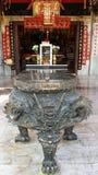 Un pote del palillo de ídolo chino (dragón negro) Fotografía de archivo