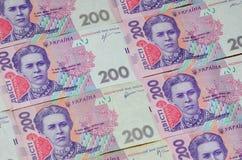 Un primer de un modelo de muchos billetes de banco ucranianos de la moneda con una paridad del hryvnia 200 Imagen de fondo en neg Fotografía de archivo libre de regalías