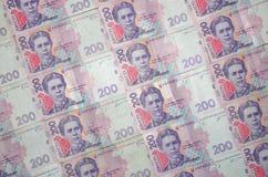 Un primer de un modelo de muchos billetes de banco ucranianos de la moneda con una paridad del hryvnia 200 Imagen de fondo en neg Imagen de archivo libre de regalías