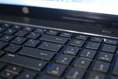 Un primer del teclado del ordenador portátil programación Desarrollo del Web site imagenes de archivo