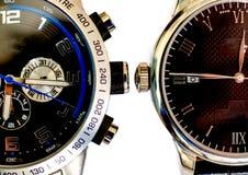 Un primo piano di due orologi Immagine Stock Libera da Diritti
