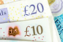 Un primo piano di 10 e 20 banconote di GBP Immagine Stock Libera da Diritti