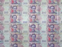 Un primo piano di un modello di molte banconote ucraine di valuta con un valore nominale del hryvnia 200 Immagine di sfondo sull' Immagine Stock