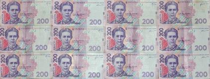 Un primo piano di un modello di molte banconote ucraine di valuta con un valore nominale del hryvnia 200 Immagine di sfondo sull' Fotografia Stock
