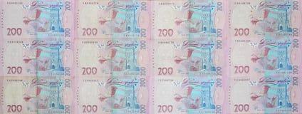 Un primo piano di un modello di molte banconote ucraine di valuta con un valore nominale del hryvnia 200 Immagine di sfondo sull' Fotografie Stock Libere da Diritti