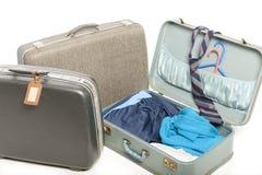 Un primo piano di tre vecchie valigie Fotografia Stock