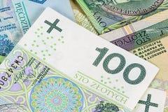 Un primo piano di una banconota di 100 pln Fotografia Stock