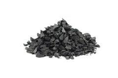 Un puñado de carbón de leña machacado fotografía de archivo
