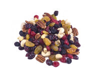 Un puñado de frutos secos y de nueces en un fondo blanco Imagen de archivo libre de regalías