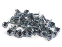 Un puñado de tornillos. Foto de archivo