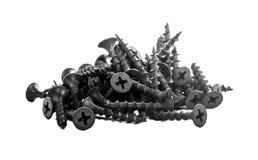 Un puñado de tornillos de metal fotografía de archivo