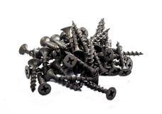 Un puñado de tornillos de metal foto de archivo libre de regalías