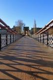 Un puente victorian viejo del pie sobre el río Clyde imágenes de archivo libres de regalías