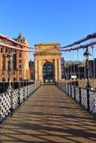 Un puente victorian viejo del pie sobre el río Clyde fotografía de archivo