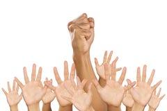 Un pugno e lle mani sollevate. immagine stock