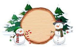Un pupazzo di neve sull'insegna di legno illustrazione di stock