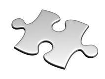 Un puzzle d'argento isolato su bianco Fotografia Stock Libera da Diritti