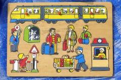 Un puzzle di legno del ` s dei bambini Fotografie Stock Libere da Diritti