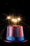Un quarto festivo del cappello di luglio con gli sparklers Fotografie Stock