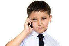 Un ragazzo che comunica sul telefono Fotografia Stock Libera da Diritti