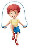 Un ragazzo che gioca con la corda Fotografia Stock
