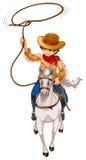Un ragazzo che monta un cavallo con un cappello e una corda Fotografia Stock Libera da Diritti