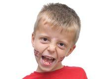 Un ragazzo di sette anni con la vernice del fronte del Jack del sindacato. fotografie stock