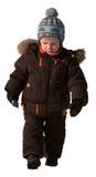 Un ragazzo di tre anni in vestiti di inverno Fotografie Stock Libere da Diritti
