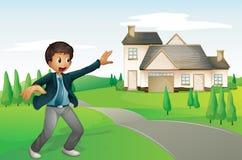Un ragazzo e una casa Fotografia Stock Libera da Diritti