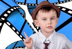 Un ragazzo su un fondo dei telai fotografia stock libera da diritti