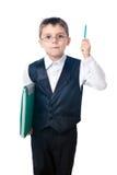 Un ragazzo sveglio che tiene una matita e un dispositivo di piegatura Fotografia Stock Libera da Diritti