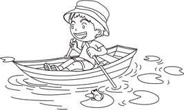 Un ragazzo in una barca Fotografia Stock Libera da Diritti