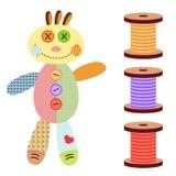 Un ragdoll de fille et quatre boutons Photo libre de droits