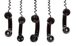Un receptor de teléfono negro en un fondo blanco Imágenes de archivo libres de regalías