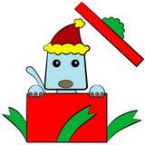Un regalo de la Navidad del perrito Fotografía de archivo libre de regalías