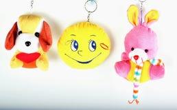 Coniglio del giocattolo, cane, smiley della bambola Fotografie Stock Libere da Diritti