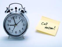 Un reloj de alarma y un No. del amarillo Imágenes de archivo libres de regalías