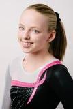 Un retrato de un gimnasta en un fondo blanco. Imagen de archivo libre de regalías