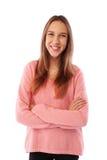 Un retrato de una sonrisa encantadora de bastante adolescente contra el blanco Foto de archivo