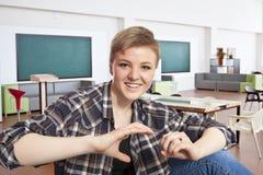 Un retrato del estudiante de la felicidad de la universidad Fotos de archivo