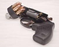 Un revólver con un cargador de la velocidad Foto de archivo libre de regalías