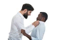 Un ritratto del primo piano di una discussione pazza sviluppata di due uomini, Immagine Stock Libera da Diritti