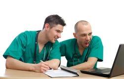 Medici annoiati e stanchi Fotografia Stock